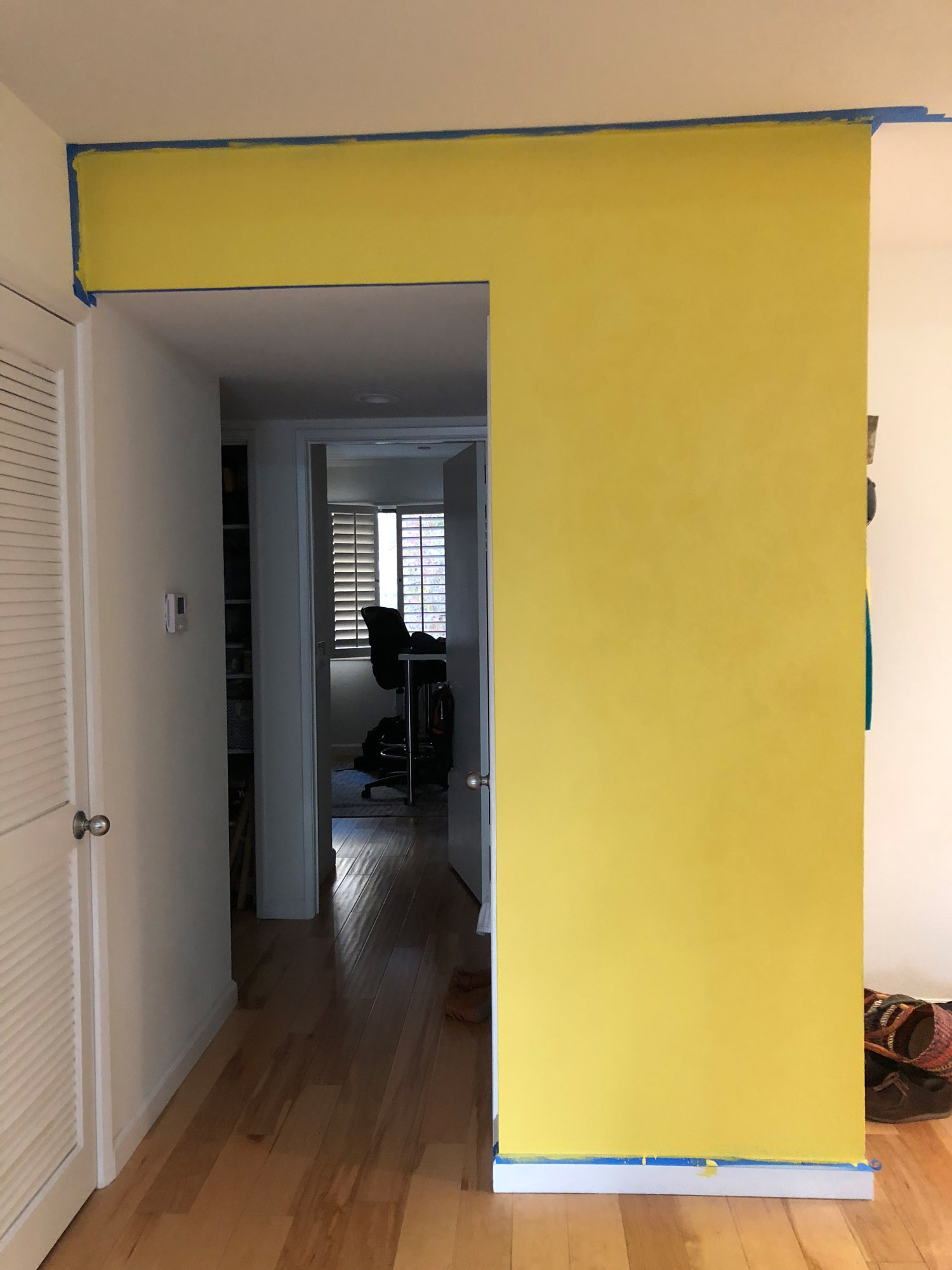 Tada! Our newly yellow entry wall