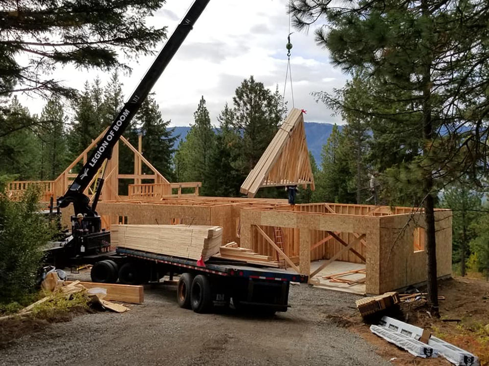Flying in the garage trusses. Image via JT Custom Homes