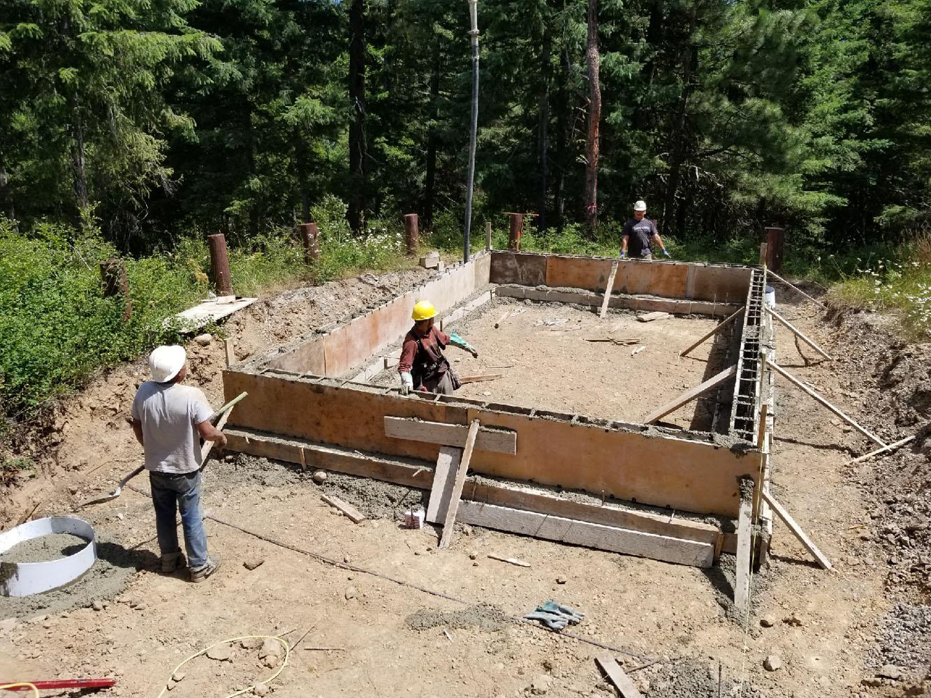 Laying the bath house foundation. Image via JT Custom Homes