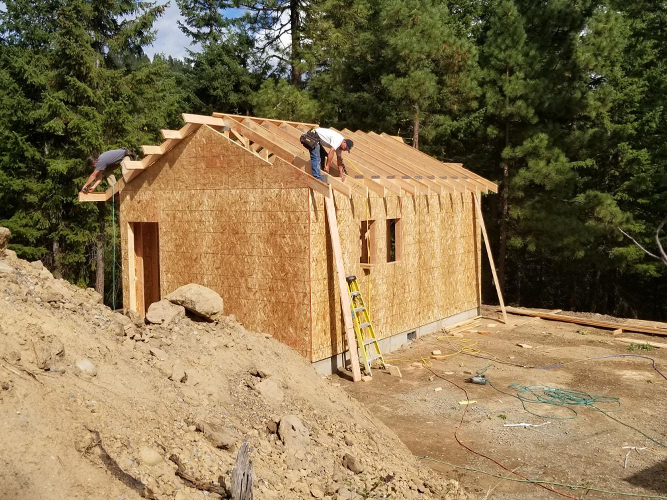 Framing the bath house. Image via JT Custom Homes